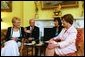 Laura Bush talks with Viktorie Spidlova, wife of the Prime Minister of the Czech Republic Vladimir Spidla, during a coffee hosted in her honor at the White House Tuesday, July 15, 2003. White House photo by Susan Sterner.