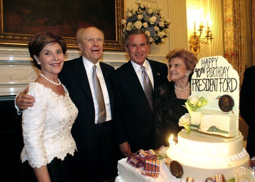 President George W. Bush and Laura Bush pose with former President Gerald R. Ford and wife Betty Ford during the presentation of the birthday cake at the Dinner in Honor of President Ford's 90th Birthday at the White House, Wednesday, July 16, 2003. White House photo by Eric Draper.