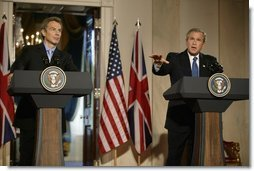 President George W. Bush speaks during a news conference with British Prime Minister Tony Blair in the Cross Hall of the White House, Thursday, July 17, 2003  White House photo by Paul Morse