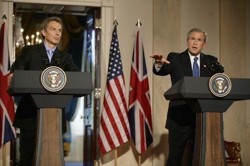 President George W. Bush speaks during a news conference with British Prime Minister Tony Blair in the Cross Hall of the White House, Thursday, July 17, 2003. White House photo by Paul Morse.