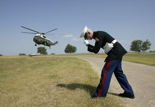 Italian Prime Minister Silvio Berlusconi arrives aboard a Marine helicopter at the Bush Ranch in Crawford, Texas, Sunday, July 20, 2003. White House photo by Eric Draper