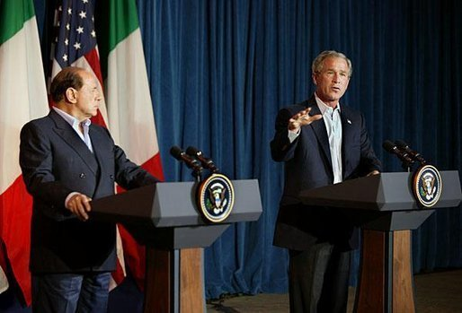President George W. Bush welcomes Silvio Berlusconi, the Prime Minister of Italy, after his arrival at the Bush Ranch in Crawford, Texas, Sunday, July 20, 2003. White House photo by Paul Morse