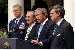 Listing recent achievements reached in Iraq, President George W. Bush holds a press conference in the Rose Garden, Wednesday, July 23, 2003. Standing with the President are Chairman of the Joint Chiefs of Staff General Richard Myers, Secretary of Defense Donald Rumsfeld and Presidential Envoy to Iraq Ambassador Paul Bremer.  White House photo by Paul Morse