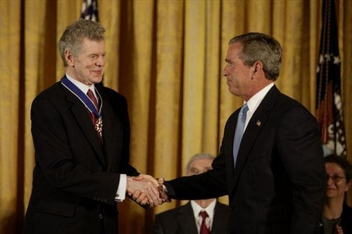 President George W. Bush presents the Presidential Medal of Freedom to Van Cliburn during a ceremony in the East Room Wednesday, July 23, 2003. Mr. Cliburn is a concert pianist whose talents have inspired countless artists. White House photo by Paul Morse