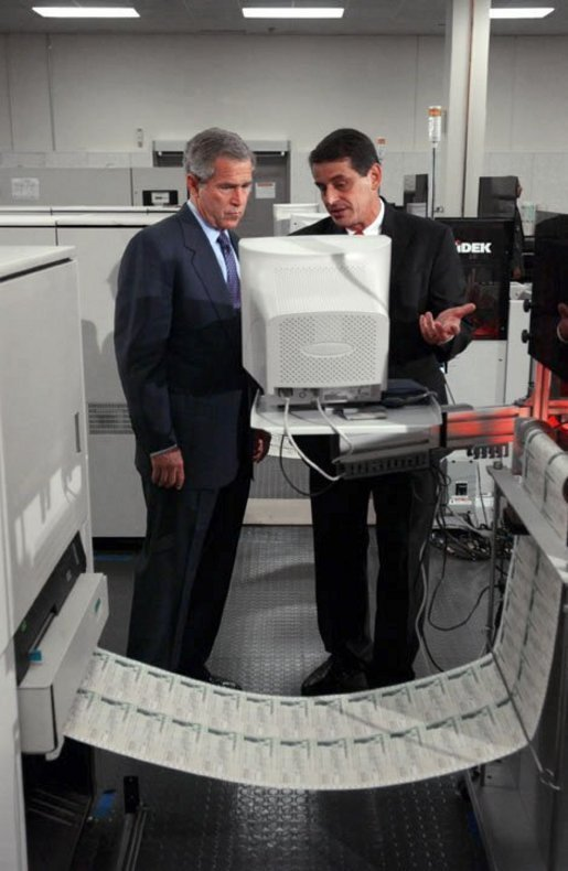 President George W. Bush and regional director Mike Colarusso tour the Department of the Treasury's Philadelphia Financial Management Service Facility July 24, 2003. White House photo by Tina Hager