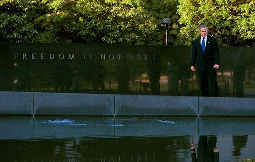 "President George W. Bush tours the Korean War Veterans Memorial in Washington, D.C., Friday, July 25, 2003. ""This memorial is -- and those who served in Korea also remind us of the challenges we face today, and it gives us a chance to reflect on the sacrifices that are being made on behalf of freedom today. And our nation will be eternally grateful for the men and women who serve today, as we are for those who have served in the past,"" said the President to the press at the memorial. Sunday, July 27, marks the 50th anniversary of the signing of the armistice that ended the Korean War. White House photo by Paul Morse."