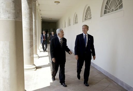President George W. Bush and Palestinian Prime Minister Mahmoud Abbas walk along the colonnade after their joint press conference in the Rose Garden Friday, July 25, 2003. Meeting for the first time at the White House, the two leaders held a working lunch and a meeting in the Oval Office. White House photo by Paul Morse.