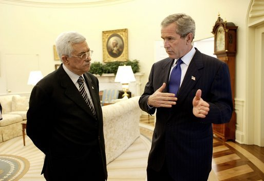 President George W. Bush and Palestinian Prime Minister Mahmoud Abbas meet in the Oval Office Friday, July 25, 2003. Meeting for the first time at the White House, the two leaders also held a working lunch and a joint press conference in the Rose Garden. White House photo by Eric Draper.