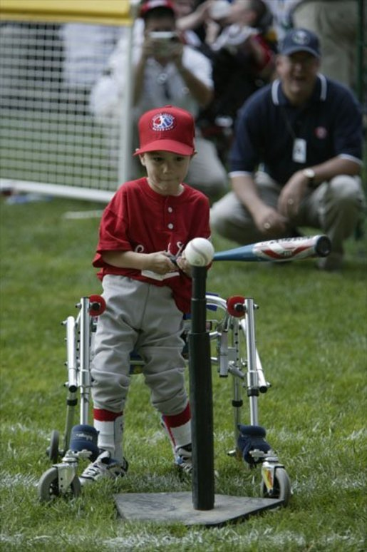 A slugger from Leedom Little League sets his mark during a game in the White House South Lawn Tee-Ball League Sunday, July 27, 2003. White House photo by Lynden Steele.