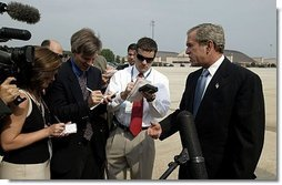 "President George W. Bush discusses the death of entertainer with the press Bob Hope as he boards Air Force One July 28, 2003. ""Today America lost a great citizen. We mourn the passing of Bob Hope. Bob Hope made us laugh, and he lifted our spirits. Bob Hope served our nation when he went to battlefields to entertain thousands of troops from different generations,"" said the President.  White House photo by Paul Morse"