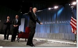 President George W. Bush waves after speaking at the 2003 National Urban League Conference in Pittsburgh Monday, July 28, 2003.  White House photo by Paul Morse