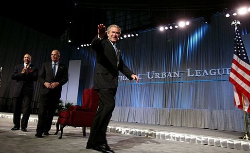 President George W. Bush waves after speaking at the 2003 National Urban League Conference in Pittsburgh Monday, July 28, 2003. White House photo by Paul Morse.