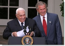President George W. Bush and Israeli Prime Minister Ariel Sharon laugh together during their joint press conference in the Rose Garden Tuesday, July 29, 2003.  White House photo by Paul Morse