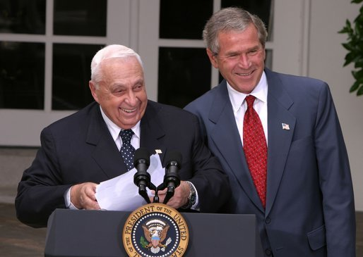 President George W. Bush and Israeli Prime Minister Ariel Sharon laugh together during their joint press conference in the Rose Garden Tuesday, July 29, 2003. White House photo by Paul Morse.