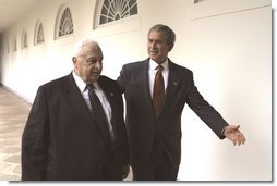 President George W. Bush and Israeli Prime Minister Ariel Sharon walk through the Rose Garden colonnade after their joint press conference Tuesday, July 29, 2003.  White House photo by Paul Morse