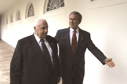 President George W. Bush and Israeli Prime Minister Ariel Sharon walk through the Rose Garden colonnade after their joint press conference Tuesday, July 29, 2003. White House photo by Paul Morse.