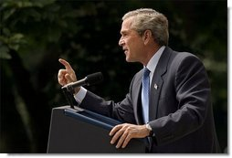 President George W. Bush addresses the media during a Rose Garden news conference Wednesday, July 30, 2003. President Bush discussed many topics including progress in Iraq, the Middle East, and the economy.  White House photo by Paul Morse