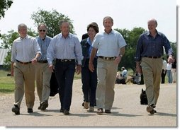 After talking with the press, President George W. Bush walks with his economic advisors at his ranch in Crawford, Texas, Wednesday, August 13, 2003. Pictured are, from left, Director of the Office of Management and Budget Josh Bolten, Assistant to the President for Economic Policy Stephen Friedman, Secretary of Commerce Don Evans, Secretary of Labor Elaine Chao and Secretary of the Treasury John Snow.   White House photo by Susan Sterner