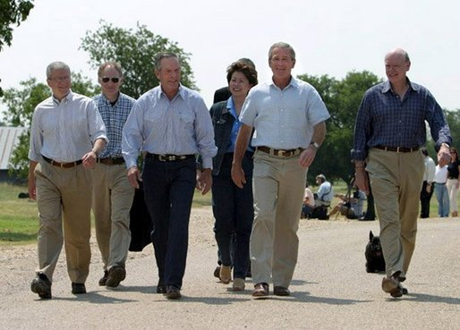 After talking with the press, President George W. Bush walks with his economic advisors at his ranch in Crawford, Texas, Wednesday, August 13, 2003. Pictured are, from left, Director of the Office of Management and Budget Josh Bolten, Assistant to the President for Economic Policy Stephen Friedman, Secretary of Commerce Don Evans, Secretary of Labor Elaine Chao and Secretary of the Treasury John Snow.  White House photo by Susan Sterner.