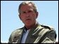 President George W. Bush makes remarks to military personnel and their families at Marine Air Corps Station Miramar near San Diego, CA on August 14, 2003. White House photo by Paul Morse.