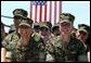 Marines react to remarks by President George W. Bush to military personnel and their families at Marine Air Corps Station Miramar near San Diego, CA on August 14, 2003. White House photo by Paul Morse.