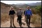 President George W. Bush walks with Secretary of the Interior Gale Norton, left, and Director of the National Park Service Fran Mainella at the Santa Monica Mountains National Recreation Area in Thousand Oaks, Calif., August 15, 2003. White House photo by Paul Morse.