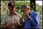 President George W. Bush smells a branch of sage with Ralph Waycott, volunteer coordinator of the Rancho Sierra Vista Nursery, during a tour of the Santa Monica Mountains National Recreation Area in Thousand Oaks, Calif., August 15, 2003. White House photo by Paul Morse.