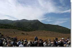As hills in the Santa Monica Mountains National Recreation Area roll through the landscape, President George W. Bush delivers remarks with Secretary of the Interior Gale Norton in Thousand Oaks, Calif. File photo.  White House photo by Paul Morse