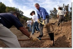 Working alongside volunteers, President George W. Bush lends a hand in repairing the Old Boney Trail at the Santa Monica Mountains National Recreation Area in Thousand Oaks, Calif. File photo.  White House photo by Paul Morse