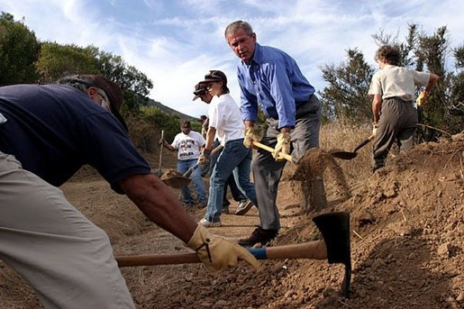 Working alongside volunteers, President George W. Bush lends a hand in repairing the Old Boney Trail at the Santa Monica Mountains National Recreation Area in Thousand Oaks, Calif. File photo. White House photo by Paul Morse.