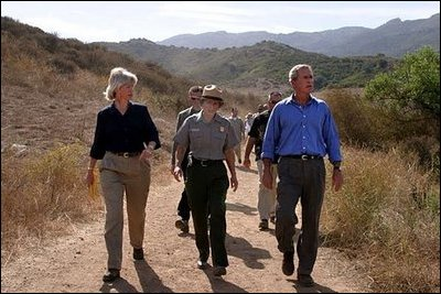 President George W. Bush walks with Secretary of the Interior Gale Norton, left, and Director of the National Park Service Fran Mainella at the Santa Monica Mountains National Recreation Area in Thousand Oaks, Calif. File photo. White House photo by Paul Morse. White House photo by Paul Morse
