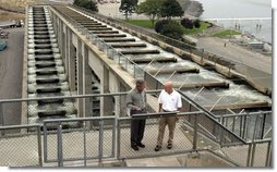 President George W. Bush talks with Witt Anderson during a tour of the Ice Harbor Lock and Dam in Burbank, Wash., Friday,August 22, 2003.  White House photo by Paul Morse