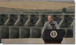 "President George W. Bush discusses salmon restoration from Ice Harbor Locks and Dam in Burbank, Wash., Friday, August 22, 2003. ""I was pleased to see the incredible care that goes in to protecting the salmon that journey up the river. It's an important message to send to people, it seems like to me, that a flourishing salmon population is a vital part of the vibrancy of this incredibly beautiful part of our country,"" said the President in his remarks about his tour of the facility.  White House photo by Paul Morse"