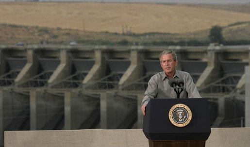 "President George W. Bush discusses salmon restoration from Ice Harbor Locks and Dam in Burbank, Wash., Friday, August 22, 2003. ""I was pleased to see the incredible care that goes in to protecting the salmon that journey up the river. It's an important message to send to people, it seems like to me, that a flourishing salmon population is a vital part of the vibrancy of this incredibly beautiful part of our country,"" said the President in his remarks about his tour of the facility. White House photo by Paul Morse."