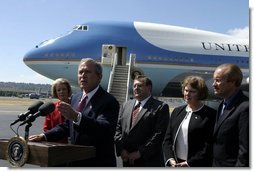 President George W. Bush talks with the media after stopping in Seattle, Wash., Friday, August 22, 2003. President Bush discussed a range of issues including his tax plan, the fires in Oregon, Iraq, and the Middle East.  White House photo by Paul Morse