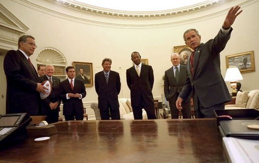 During the presentation of the official NFL football of the 2003 season, President George W. Bush gives a tour of the Oval Office Tuesday, Sept. 2, 2003. The Washington Redskins play the New York Jets Thursday. Pictured with the President are, from left, NFL Commissioner Paul Tagliabue, former Washington Redskin Sonny Jurgenson, Washington Redskins team owner Dan Snyder, former New York Jets quarterback Joe Namath, Executive Director of the NFL Players Association Gene Upshaw, and New York Jets team owner Woody Johnson. White House photo by Tina Hager.