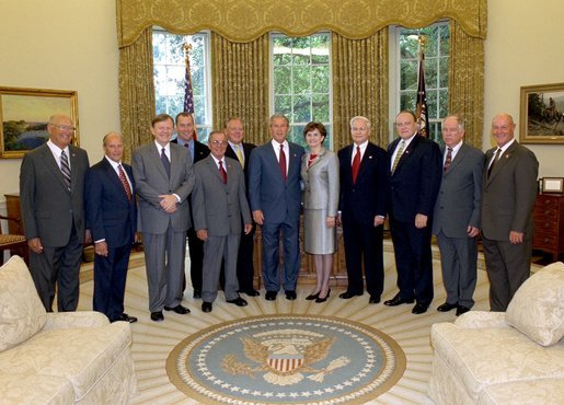 President George W. Bush stands with Mississippi legislators who switched from the Democratic Party to the Republican Party in the Oval Office Tuesday, Sept. 2, 2003. White House photo by Tina Hager.