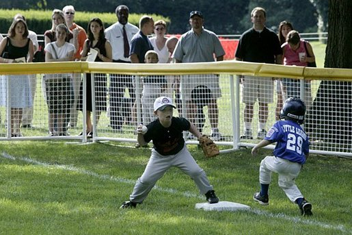 The first basemen from the Hamilton Little Lads Cal Ripken League of Hamilton, N.J., makes a play during a fast-paced game against the Milwood Little League of Kalamazoo, Mich., during the last game of the 2003 White House South Lawn Tee Ball season Sunday, Sept. 7, 2003. White House photo by Lynden Steele.