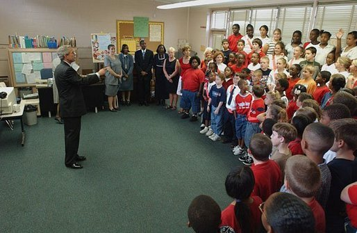 President George W. Bush is greeted by students at Hyde Park Elementary School in Jacksonville, Fla., Tuesday, Sept. 9, 2003. White House photo by Tina Hager