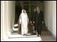 President George W. Bush and Prime Minister Sheikh Sabah al Ahmad al-Jabir Al Sabah of Kuwait walk along the colonnade after the two leaders met with reporters in the Oval Office Wednesday, Sept. 10, 2003. White House photo by Paul Morse.