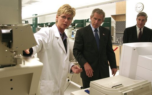 President George W. Bush and FBI Director Robert Mueller watch as chemist Eileen Waninger, left, demonstrates a TSQ - 1 ThermoFinnigan Triple Stage Quadruple GC/MS instrument during a tour of the new FBI Laboratory in Quantico, Va., Wednesday, Sept. 10, 2003. The TSQ-1 has been used to identify chemical components for the Embassy bombings in Africa, attack on USS Cole and the bombing of United Nations in Iraq. White House photo by Paul Morse