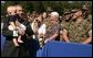 President George W. Bush holds 7-month-old Frank Antonelli, whose father is a major in the Marine corps, as he greets workers at the FBI Academy in Quantico, Va., Wednesday, Sept. 10, 2003. White House photo by Paul Morse