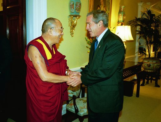 President George W. Bush welcomes the Dalai Lama to the White House Wednesday, September 10, 2003. White House photo by Paul Morse.