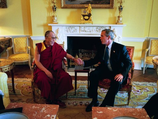 President George W. Bush meets with the Dalai Lama at the White House Wednesday, September 10, 2003. White House photo by Paul Morse.
