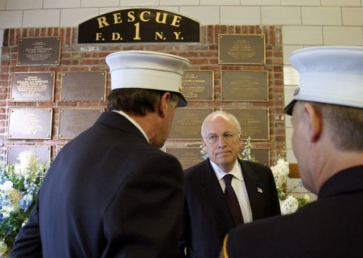 Commemorating the two-year anniversary of the terrorist attacks, Vice President Dick Cheney visits the firehouse of FDNY Rescue Company 1 in New York, N.Y., Sept. 11, 2003. Pictured in the background is a memorial to the station's firefighters who have died in the line of duty, including the company's eleven firefighters who lost their lives Sept. 11, 2001. White House photo by David Bohrer.
