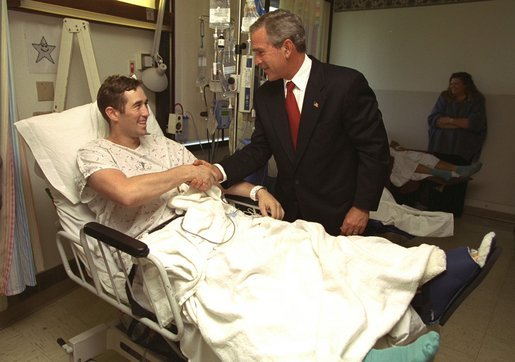 President George W. Bush shakes hands with Staff Sgt. Ethan Craig of Chester, Mass., after awarding him The Purple Heart at Walter Reed Army Medical Center Thursday, Sept. 11, 2003. Visiting with patients who were injured while serving in Operation Iraqi Freedom, President Bush awarded 11 Purple Hearts. White House photo by Paul Morse.