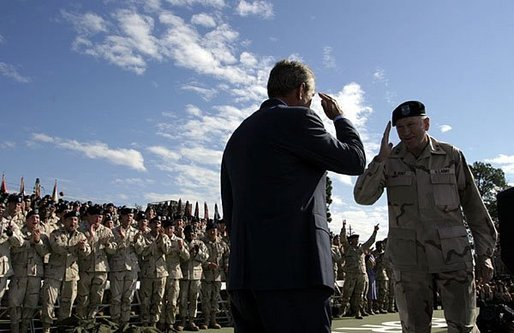 President George W. Bush salutes Major General Buford Blount, Commander of the 3rd Infantry Division (Mechanized) before addressing military personnel and their families at Ft. Stewart, Ga., Friday, Sept. 12, 2003. White House photo by Paul Morse
