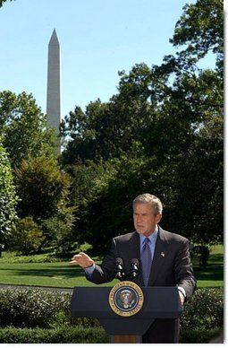 President George W. Bush discusses his Clear Skies Initiative in the East Garden Tuesday, Sept. 16, 2003. The initiative mandates a 70 percent cut in air pollution from power plants over the next 15 years, including the first-ever national cap on mercury emissions.  White House photo by Tina Hager