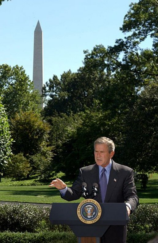 President George W. Bush discusses his Clear Skies Initiative in the East Garden Tuesday, Sept. 16, 2003. The initiative mandates a 70 percent cut in air pollution from power plants over the next 15 years, including the first-ever national cap on mercury emissions. White House photo by Tina Hager.