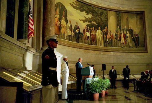 "President George W. Bush delivers remarks at the rededication ceremony of the National Archives Wednesday, Sept. 17, 2003. During the ceremony, the Declaration of Independence, the Constitution, and the Bill of Rights were unveiled. ""In the course of two centuries, the ideals of our founding documents have defined America's purposes in the world,"" said the President. ""Since July 4th, 1776, to this very day, Americans have seen freedom's power to overcome tyranny, to inspire hope even in times of great trial, to turn the creative gifts of men and women to the pursuits of peace."" White House photo by Paul Morse"